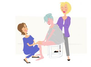 Image of Woman giving birth on a birth stall - copyright New Life Classes