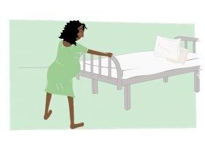 Image of Woman leaning against the bed whilst giving birth - copyright New Life Classes
