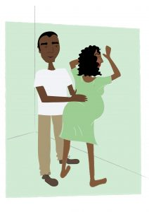 Image of Woman leaning against the wall with birth partner - copyright New Life Classes