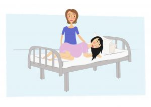 Image of Woman giving birth lying on her left hand side - copyright New Life Classes